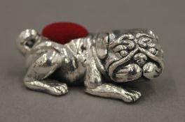 A silver pin cushion in the form of a bulldog. 4.5 cm long.