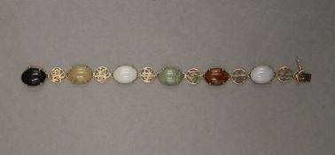 A Chinese 14 K gold and agate bracelet. 18.5 cm long. 16.3 grammes total weight.