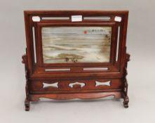 A Chinese Dali marble dream stone screen in a hardwood frame. 38 cm high.