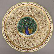 A boxed Indian gold leaf embellished marble plaque. 30 cm diameter.