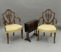 A pair of reproduction open armchairs and a Victorian Sutherland table. The chairs 58 cm wide.