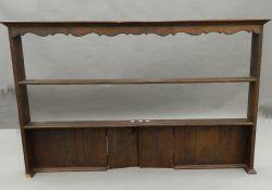 An oak dresser rack. 164.5 cm wide.