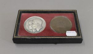 A leather cased pair of King George VI and Queen Elizabeth coronation medallions
