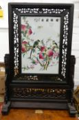 A Chinese porcelain and carved wooden table screen