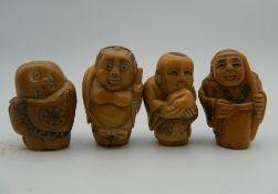 Four carved bone netsuke. Each approximately 3.5 cm high.