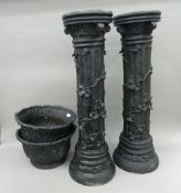 Two modern planters on stands. 106 cm high.