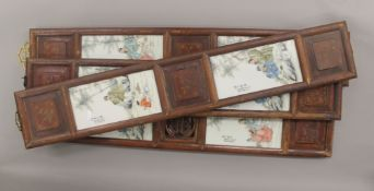 Four Chinese porcelain plaques, housed in wooden frames. The largest 96 cm high.