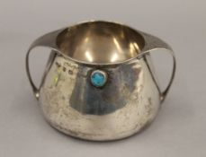 A Liberty & Co Cymric silver twin handled bowl. 7 cm high. 6.3 troy ounces total weight.