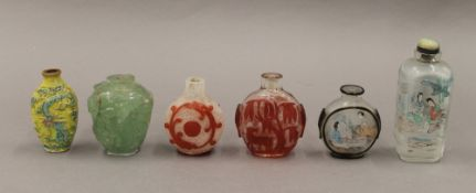 A collection of Chinese snuff bottles. The largest 9.5 cm high.