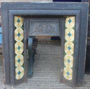 A Victorian cast iron fireplace. 96.5 cm wide x 96.5 cm high.