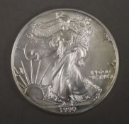An one ounce solid silver dollar