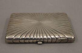 A Russian silver starburst cigarette case. 11.5 cm wide. 8 troy ounces.