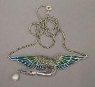 A silver plique-a-jour bird pendant on chain. The pendant 7.5 cm wide.