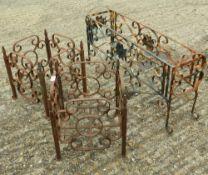 Three wrought iron planters