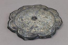 A Chinese bronze mirror. 21 cm diameter.