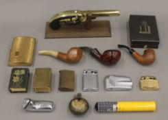A quantity of lighters, pipes, etc.