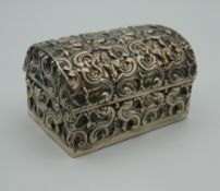 A small Continental embossed silver dome top box. 6 cm wide. 55.8 grammes total weight.