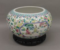 A Chinese porcelain vase on stand. 29 cm diameter.