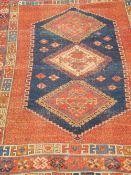 A red ground rug. 172 cm x 120 cm.