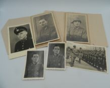 A small quantity of WWII German military photographs and a postcode of Adolf Hitler