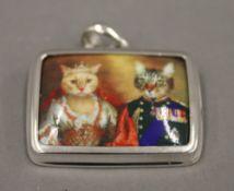 A silver enamel cat pendant. 3 cm wide.