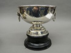 A large beaten silver punch bowl on stand. 23 cm diameter. 33.8 troy ounces of weighable silver.