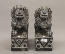 A pair of Chinese carved stone dogs-of-fo. 33 cm high.