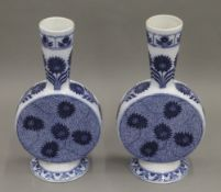 A pair of Minton blue and white porcelain vases. Each 25 cm high.