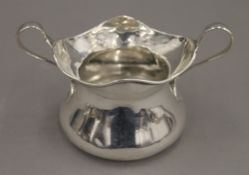 A silver Art Nouveau style sugar bowl. 11.5 cm wide. 82 grammes.