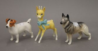 A Beswick Babysham deer and two dogs.