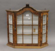 A walnut hanging display cabinet. 68 cm wide x 69 cm high.