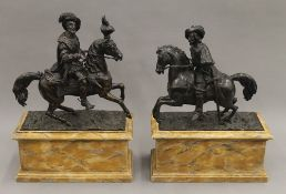 A pair of 19th century Continental patinated bronze models of nobles on horseback,