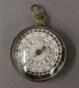 A vintage brass compass. 3.75 cm diameter.