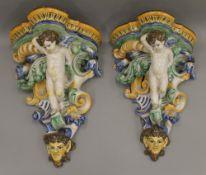 A pair of Maiolica wall brackets. Each 42 cm high.