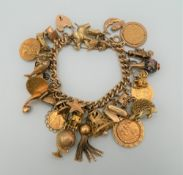 A 9 ct gold charm bracelet, set with various gold coins, including two sovereigns. 218.