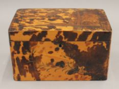 A 19th century Japanese lacquered tortoiseshell tea caddy. 19.5 cm wide.