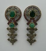 A pair of vintage drop earrings set in silver and gold, with rubies, diamonds and emeralds.