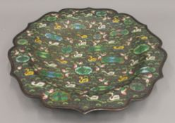 A cloisonne charger decorated with ducks. 30.5 cm diameter.