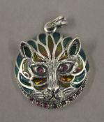A silver plique a jour cat form pendant. 3 cm wide.