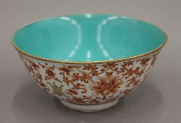 A Chinese turquoise and red porcelain bowl. 16 cm diameter.