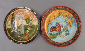 Two Persian pottery plates. The largest 26.5 cm diameter.