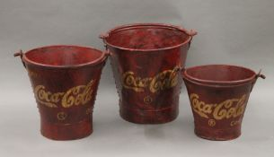 A set of three Coca-Cola buckets. The largest 30 cm high.