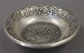 A Chinese bowl decorated with peaches. 13.5 cm diameter.