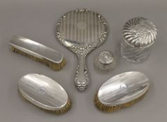 A silver dressing table set,