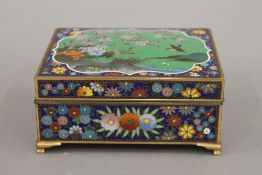 A late 19th/early 20th century cloisonne box. 12 cm wide.