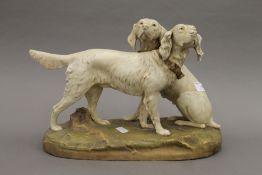 A Royal Dux porcelain model of two retrievers. 36 cm wide.