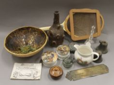 A box of miscellaneous items, including Victorian pot lids, a pottery bowl,