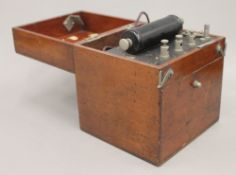 A vintage mahogany cased electric shock machine. 19 cm high.
