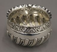 A silver fluted sugar bowl. 8 cm diameter. 69.9 grammes.