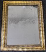 A 19th century gilt ripple moulded wall glass. 82.5 x 100 cm.